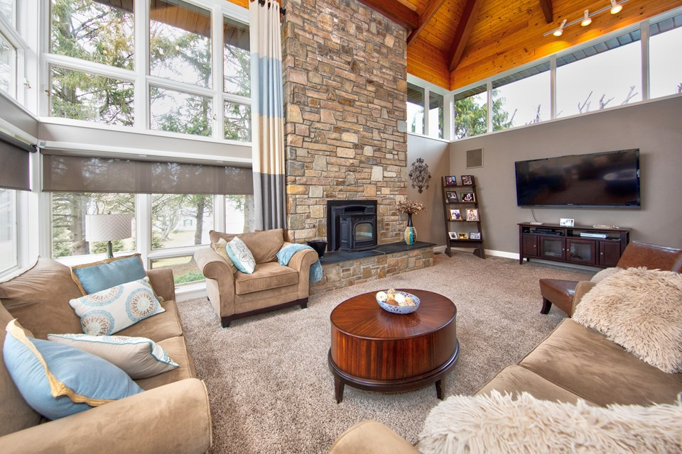 living room w/ floor to ceiling stone hearth & pellet stove
