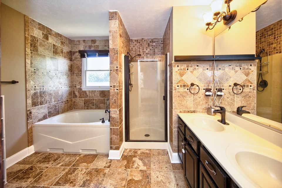master bath with dual sinks & separate soaking tub