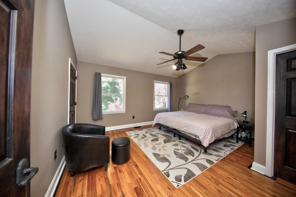 master bedroom with ceiling fan & walk in closets