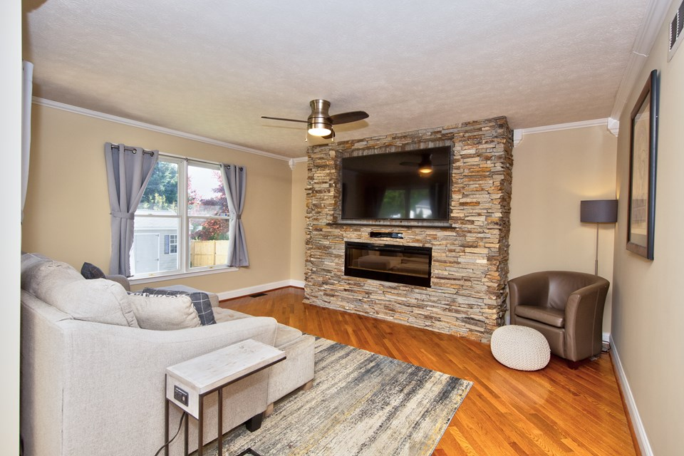 family room with electric fireplace &  70 tv included