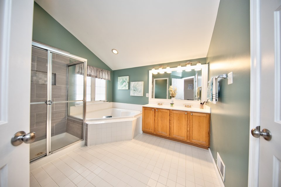 master bathroom with double sinks, soaking tub & sep shower