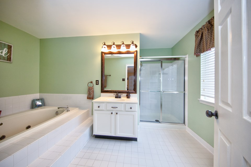 primary bathroom with soaking tub & separate shower