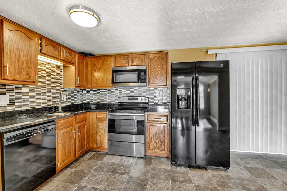 updated kitchen with granite & new appliances